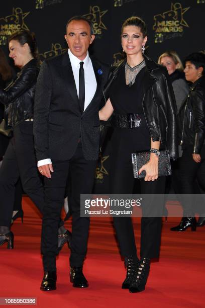 Nikos Aliagas and wife Tina Grigoriou arrive at the 20th NRJ Music Awards at Palais des Festivals on November 10 2018 in Cannes France