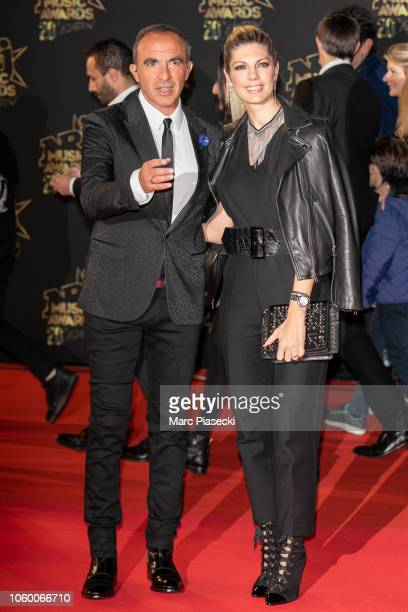Nikos Aliagas and wife Tina Grigoriou attend the 20th NRJ Music Awards at Palais des Festivals on November 10 2018 in Cannes France