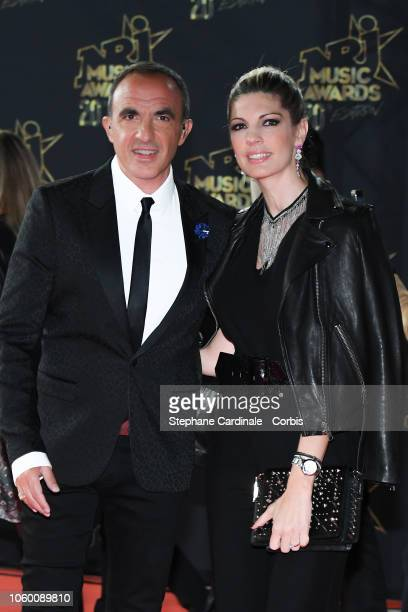 Nikos Aliagas and wife Tina Grigoriou attends the 20th NRJ Music Awards at Palais des Festivals on November 10 2018 in Cannes France