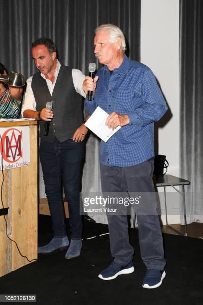 Nikos Aliagas and Yannn ArthusBertrand attend 'Les Amis de Yann ArthusBertrand se Vendent aux Encheres' Auction in Domaine de Longchamps on October...