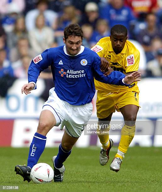 Nikos Dabizas of Leicester holds off Leon Knight of Brighton during the CocaCola Championship match between Leicester City and Brighton and Hove...