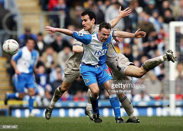 Nikos Dabizas of Leicester in action with Paul Dickov of Blackburn during the FA Cup QuarterFinal between Blackburn Rovers and Leicester City at...