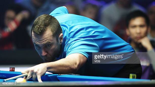 Nikos Ekonomopoulos of Greece plays a shot against Alex Pagulayan of Philippines during day three of Partypoker World Pool Masters 2014 on November...
