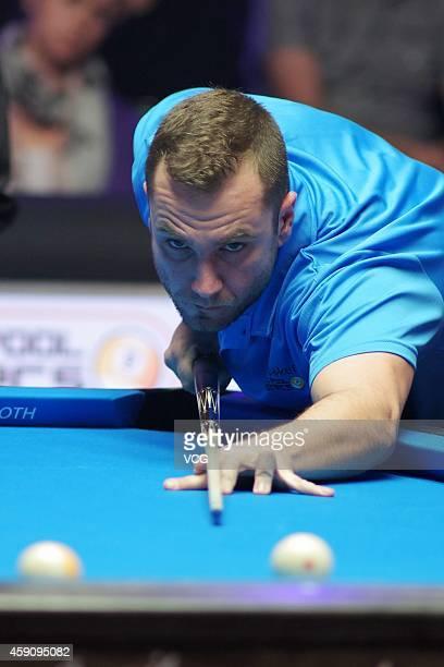 Nikos Ekonomopoulos of Greece plays a shot against Karol Skowerski of Poland during semifinal of Partypoker World Pool Masters 2014 on November 16...