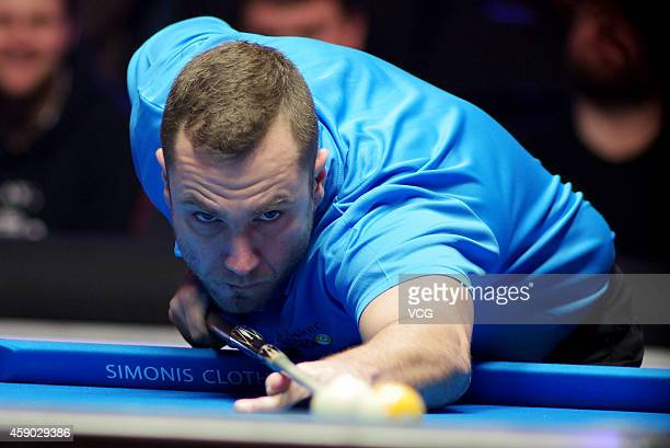 Nikos Ekonomopoulos of the Hellenic Republic plays a shot against Thorsten Hohman of Germany on day one of the Partypoker World Pool Masters 2014 at...
