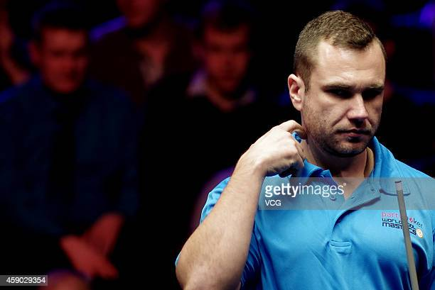 Nikos Ekonomopoulos of the Hellenic Republic reacts against Thorsten Hohman of Germany on day one of the Partypoker World Pool Masters 2014 at...