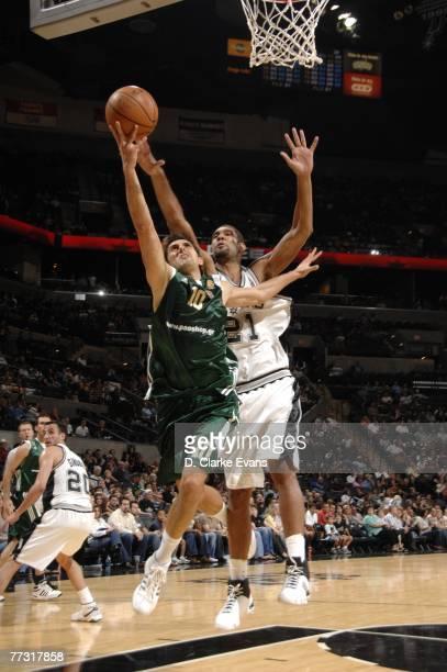 Nikos Hatzivrettas of Panathinaikos rebounds the ball against Tim Duncan of the San Antonio Spurs at the AT&T Center October 13, 2007 in San Antonio,...