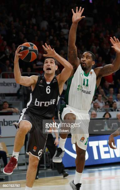 Nikos Zisis #6 of Brose Bamberg competes with Bradley Wanamaker #11 of Darussafaka Dogus in action during the 2016/2017 Turkish Airlines EuroLeague...