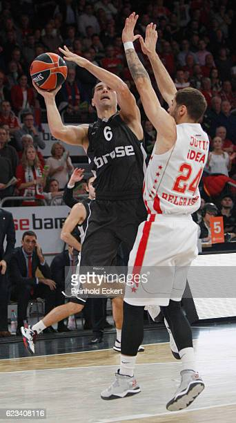 Nikos Zisis #6 of Brose Bamberg competes with Stefan Jovic #24 of Crvena Zvezda mts Belgrade in action during the 2016/2017 Turkish Airlines...