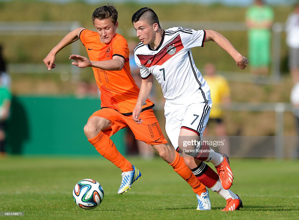 Nikos Zografakis of Germany (R) is challenged by Martijn Kaars of the Netherlands during the international friendly U15 match between Germany and Netherlands on May 20, 2014 in Weingarten, Germany.