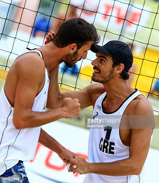 Nikos Zoupanis and Georgios Kotsilianos of Greece celebrate their point against Germay in the men's semi final match of the FIVB Antalya Open beach...