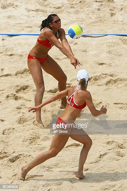 Nila Haakedal of Norway sets the ball for teammate, Ingrid Toerlen in the Women's Preliminary Pool B match against Chiaki Kusuhara and Mika Saiki of...