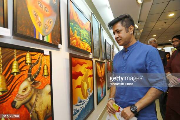 Niladri Paul during an opening of the group show Creciente at AIFACS Rafi Marg on September 29 2017 in New Delhi India The show brought together...