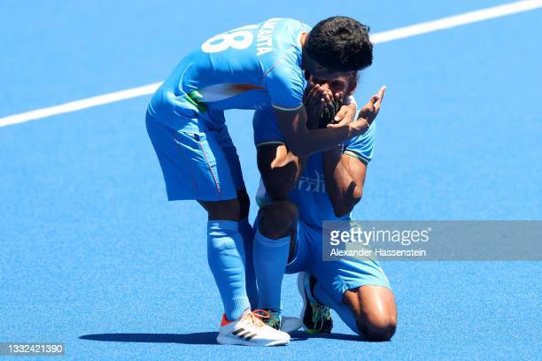 Nilakanta Sharma and Hardik Singh of Team India celebrate after winning the Men's Bronze medal match between Germany and India on day thirteen of the...