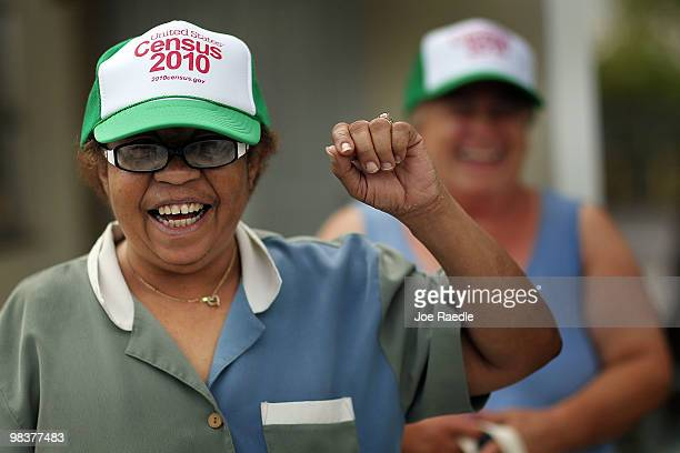 Nilda Borroto and Maria Perales show off their new census hats given to them by census workers taking part in the 'March to the Mailbox' effort on...