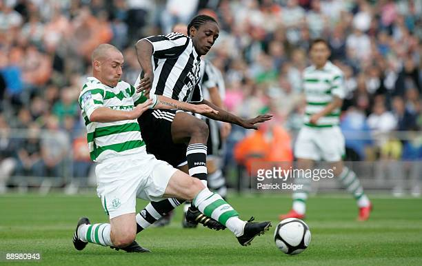 Nile Ranger of Newcastle and Barry Johnston of Shamrock Rovers in action during the preseason friendly match between Shamrock Rovers and Newcastle...