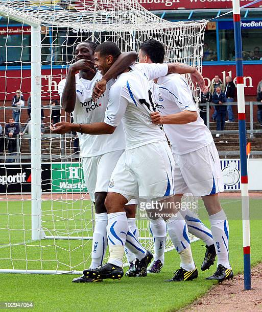 Nile Ranger of Newcastle celebrates after scoring his team's second goal with team mates Leon Best and Haris Vuckic during a preseason friendly match...