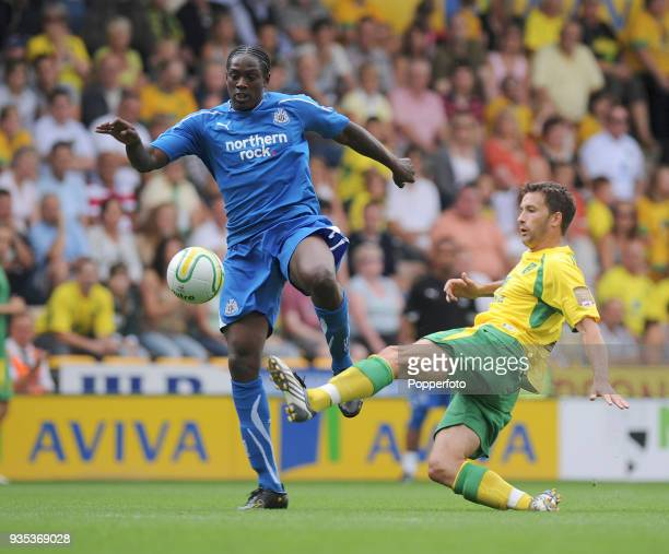 Nile Ranger of Newcastle United is denied by Adam Drury of Norwich City during the Pre Season Friendly match between Norwich City and Newcastle...