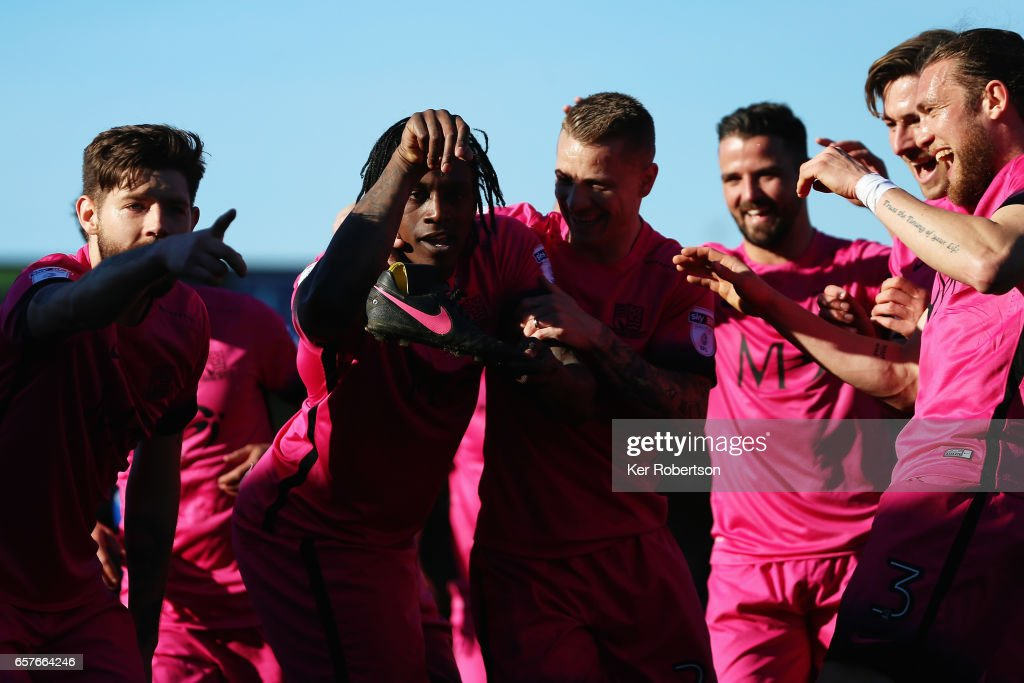 Nile Ranger (2nd L) of Southend United celebrates with team mates after scoring during the Sky Bet League One match between A.F.C. Wimbledon v Southend United at the Cherry Red Records Stadium on March 25, 2017 in Kingston upon Thames, United Kingdom.