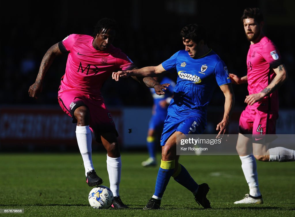 Nile Ranger of Southend United holds off the challenge of Will Nightingale of A.F.C. Wimbledon during the Sky Bet League One match between A.F.C. Wimbledon v Southend United at the Cherry Red Records Stadium on March 25, 2017 in Kingston upon Thames, United Kingdom.