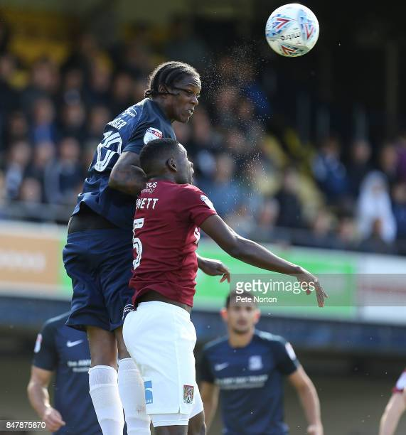 Nile Ranger of Southend United rises above Leon Barnett of Northampton Town to head the ball during the Sky Bet League One match between Southend...