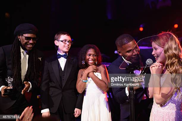 Nile Rodgers and Jamie Foxx perform onstage with Jozlyn Jaiman and Arabelle of Children's National Health System during Angel Ball 2014 hosted by...