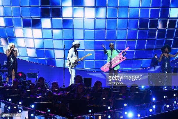 Nile Rodgers and Laura Mvula on stage during The National Lottery's Team GB homecoming event at the SSE Arena Wembley on August 15, 2021 in London,...