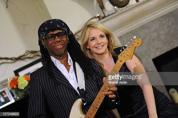 Nile Rodgers and Nancy Hunt attends an Intimate Evening with Nile Rodgers hosted by Susan and David Rockefeller on September 26 2011 in New York City