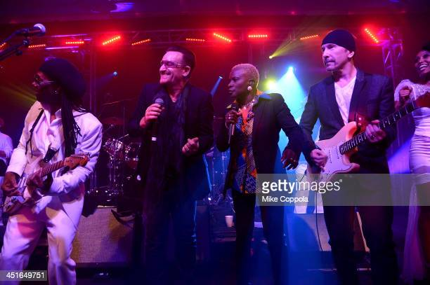 Nile Rodgers Bono Angelique Kidjo and The Edge perform onstage at the After Party for Jony And Marc's Auction at Sotheby's on November 23 2013 in New...