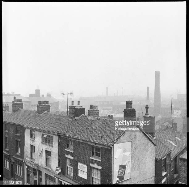 Nile Street, Burslem, Stoke-on-Trent, 1965-1968. An elevated view from a window of the George Hotel looking south with numbers 12-16 Nile Street and...