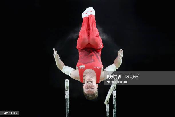 Nile Wilson of England competes on the parallel bars in the Men's Team Final and Individual Qualification during the Artistic Gymnastics on day one...
