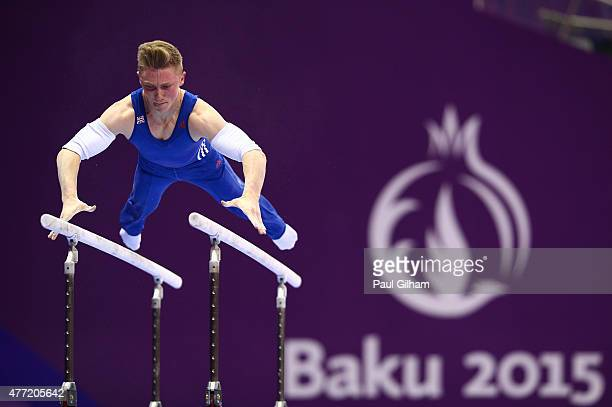 Nile Wilson of Great Britain competes on the parallel bars during the Men's Artistic Gymnastics Team and All Around qualification on day three of the...