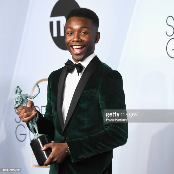 Niles Fitch winner of Outstanding Performance by an Ensemble in a Drama Series for 'This Is Us' poses in the press room during the 25th Annual Screen...