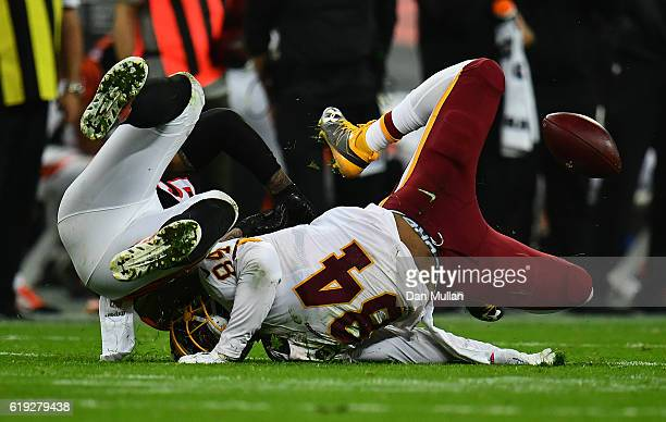 Niles Paul of the Washington Redskins collides with Rey Maualuga of the Cincinnati Bengals during the NFL International Series Game between...