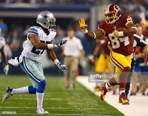 Niles Paul of the Washington Redskins is forced out of bounds by JJ Wilcox of the Dallas Cowboys during the first half at ATT Stadium on October 27...