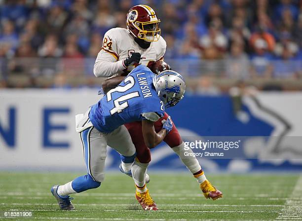 Niles Paul of the Washington Redskins is tackled by Nevin Lawson of the Detroit Lions at Ford Field on October 23 2016 in Detroit Michigan Detroit...