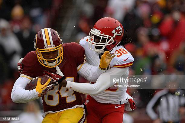 Niles Paul of the Washington Redskins is tackled by Ron Parker of the Kansas City Chiefs on a kickoff return in the second quarter during an NFL game...