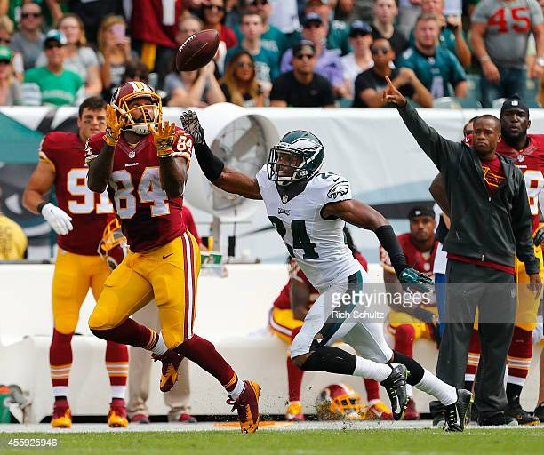 Niles Paul of the Washington Redskins makes a catch for a first down as Bradley Fletcher of the Philadelphia Eagles defends during the first quarter...