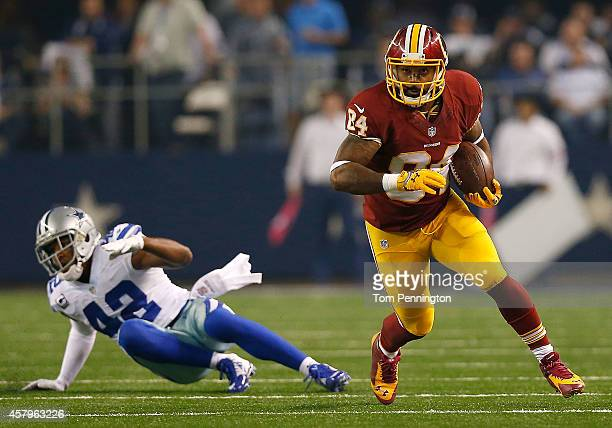 Niles Paul of the Washington Redskins runs after the catch as Barry Church of the Dallas Cowboys is unable to make the tackle during the first half...