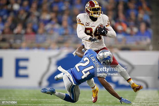 Niles Paul of the Washington Redskins runs for yardage against Nevin Lawson of the Detroit Lions during first half at Ford Field on October 23 2016...