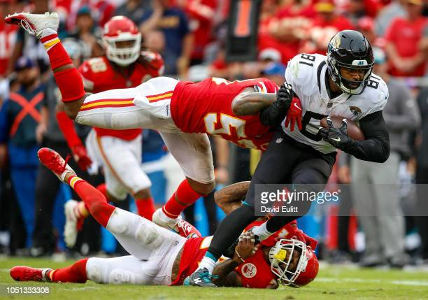 Niles Paul tight end with the Jacksonville Jaguars was tackled after a pass catch by Anthony Hitchens linebacker with the Kansas City Chiefs and...