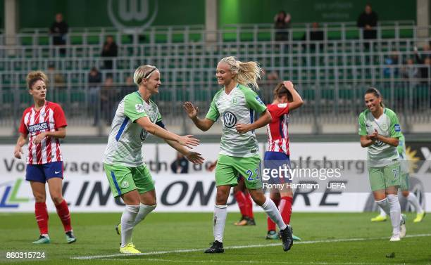 Nilla Fischer and Pernille Harder of Wolfsburg celebrate after scoring during the UEFA Women Champions League Round of 32 second leg match between...