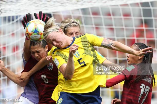 Nilla Fischer of Sweden competes for a header with Waraporn Boonsing of Thailand and Miranda Nild of Thailand during the 2019 FIFA Women's World Cup...