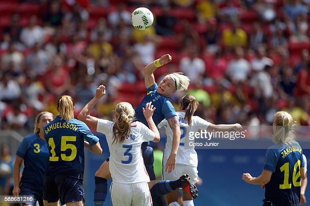 Nilla Fischer of Sweden goes up for the ball against Allie Long of United States in the first half during the Women's Football Quarterfinal match at...
