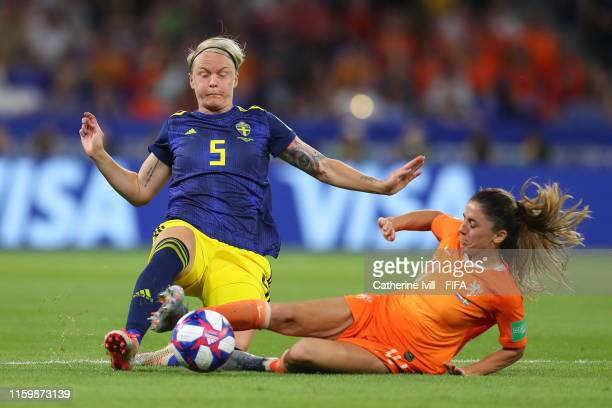 Nilla Fischer of Sweden is challenged by Danielle Van De Donk of the Netherlands during the 2019 FIFA Women's World Cup France Semi Final match...