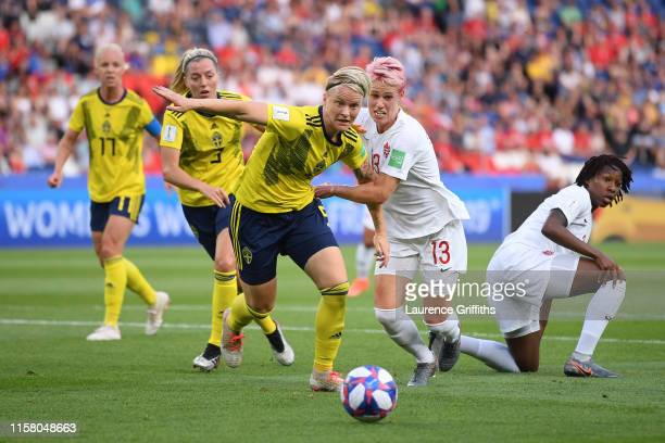 Nilla Fischer of Sweden is challenged by Sophie Schmidt of Canada during the 2019 FIFA Women's World Cup France Round Of 16 match between Sweden and...