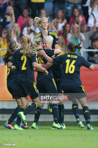 Nilla Fischer of Sweden of Sweden celebrates the first goal with her team mates during the UEFA Women's EURO 2013 Group A match between Finland and...