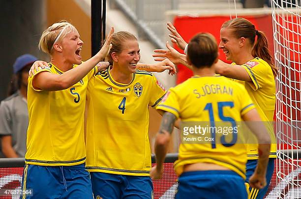 Nilla Fischer of Sweden reacts after scoring the second goal against Nigeria with Emma Berglund Therese Sjogran and Lotta Schelin during the FIFA...