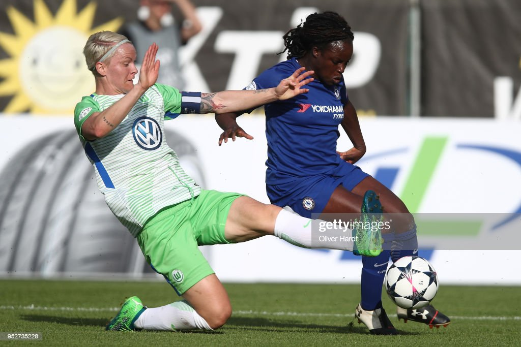 Nilla Fischer (L) of Wolfsburg and Eniola Aluko (R) of Chelsea compete for the ball during the Women's UEFA Champions League semi final second leg match between VfL Wolfsburg and FC Chelsea at AOK Stadion on April 29, 2018 in Wolfsburg, Germany.