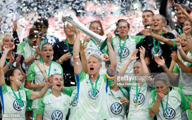 Nilla Fischer of Wolfsburg celebrates the winning of the trophy after the Women's DFB Cup Final between VFL Wolfsburg and FC Bayern Muenchen at...